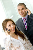 Business couple with cellular — Stock Photo