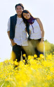 Beautiful couple in a meadow — Stock Photo