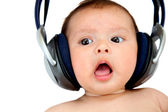 Baby with earphones — Stock Photo