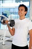Man lifting weights — Stock Photo