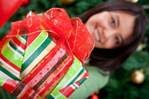 Woman giving a Christmas gift — Stock Photo
