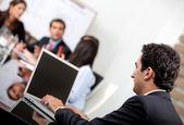 Affärsman i ett möte — Stockfoto