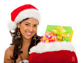 Female Santa with a gift's bag — Стоковое фото