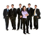 Business women in a males group — Stock Photo