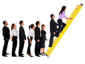 Business group climbing a ladder — Stock Photo