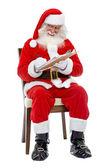Santa psaní seznam — Stock fotografie
