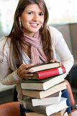 Beautiful woman with books — Stock Photo
