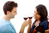 Loving couple with wineglasses — Stock Photo