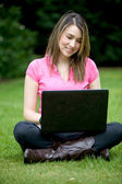 Woman with a laptop outdoors — Stock Photo
