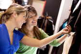 Women looking at clothes — Stock Photo