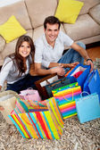 Shopping couple at home — Stock Photo