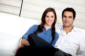 Couple in their living room — Stock Photo