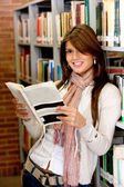 Beautiful woman at the library — Stock Photo