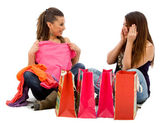 Girls looking at their purchases — Stock Photo