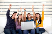 Excited group with laptop — Foto de Stock