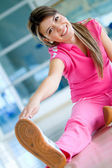Woman doing stretches — Stock Photo