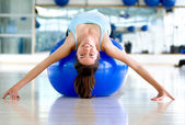 Gym woman bending backwards — Stock Photo