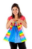 девочка с хозяйственными сумками — Стоковое фото