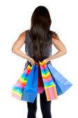 Vista posterior de una mujer de compra — Foto de Stock