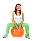 Woman sitting on a pilates ball — Stock Photo