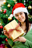 Woman with Christmas gift — Stock Photo