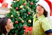 Woman giving a Christmas present — Stock Photo