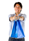 Man holding shopping bags — Stock Photo