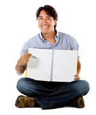 Male student with a notebook — Stock Photo