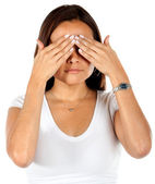 Woman covering her eyes — Stock Photo