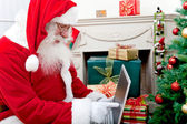 Santa Claus with a laptop — Stock Photo