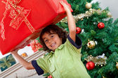 Boy with a Christmas present — Stock Photo