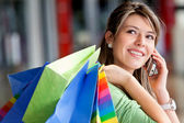 Shopping woman on the phone — Stockfoto