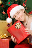 Christmas gifts by santa claus — Stock Photo