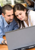 Couple on a laptop at home — Stock Photo