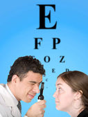 Eye test chart with doctor and patient — Stock Photo