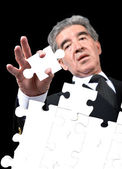 Business man solving a puzzle — Stock Photo