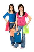 Beautiful girls with shopping bags — Стоковое фото