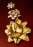 Golden ribbons on red gifts — Stock Photo