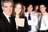 Business partners and their team — Stock Photo