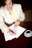 Business woman doing paperwork — Stock Photo