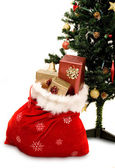 Christmas tree with sack full of gifts — Stock Photo
