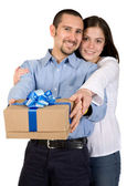 Couple with a gift — Stock Photo
