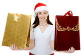 Female santa with shopping bags — Stok fotoğraf