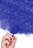 Hand drawing with a blue pencil — Stock Photo