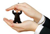 Business man protected by hands — Stock Photo