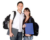 Students with books and bags — Stock Photo