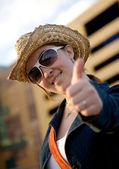 Female tourist with thumbs up — Stock Photo