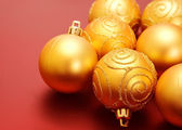 Christmas golden baubles — Stock Photo