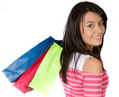 Girl in pink with shopping bags — Stock Photo