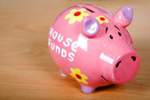 Piggy bank on a wooden surface — Stock Photo